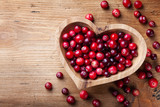 Cranberry in wooden bowl on rustic table top view. - 291542569