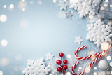 Christmas blue background. White snowflakes and holiday decoration top view. Happy New Year card.