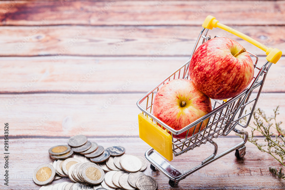 Fototapety, obrazy: Fresh apples in a shopping cart. Fruit concept spending money on healthy food.