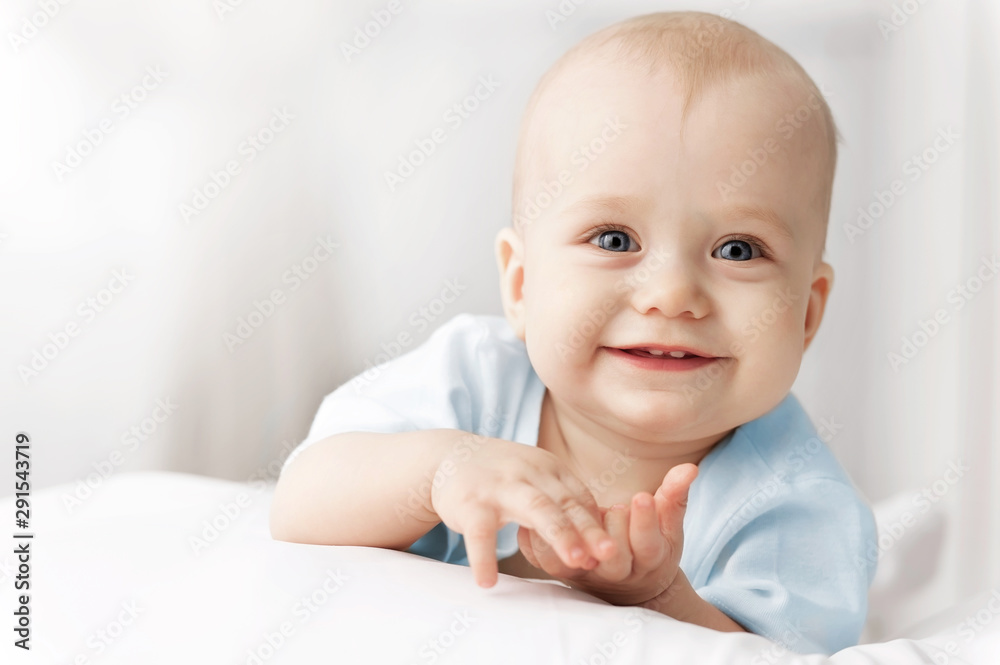 Smiling baby on the bed