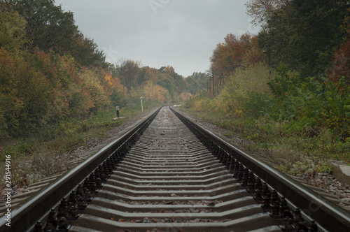 Photo Stands Railroad Autumn railway. Rails extending into the distance. prospect of estrangement