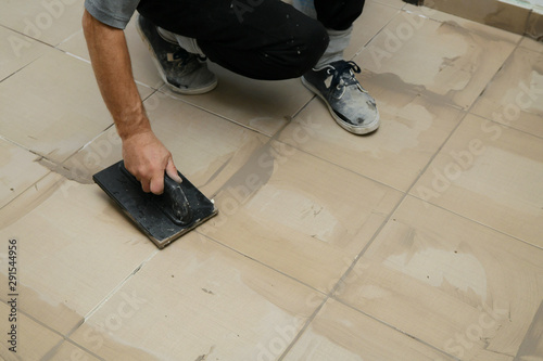 Grouting ceramic tiles, close up Canvas Print