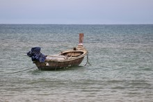 Fishing Boat In The Sea On Background Of Foggy Tropical Coast. Picturesque Seascape In Sunny Day