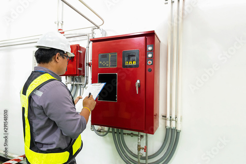 Leinwand Poster Engineer check generator pump controller for water sprinkler piping and fire protection system