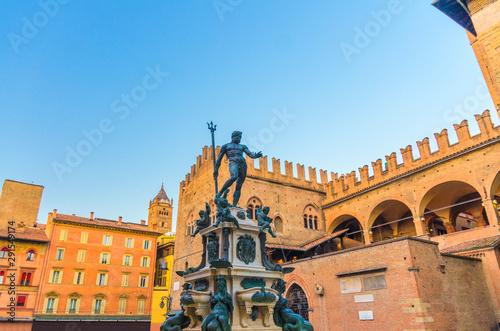 Neptune Fountain Fontana del Nettuno and Palazzo Re Enzo palace building on Piazza del Nettuno Neptune square in old historical city center of Bologna, Emilia-Romagna, Italy
