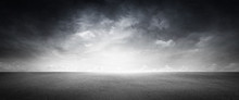 Black Floor Dark Background With Gray Sky And White Clouds
