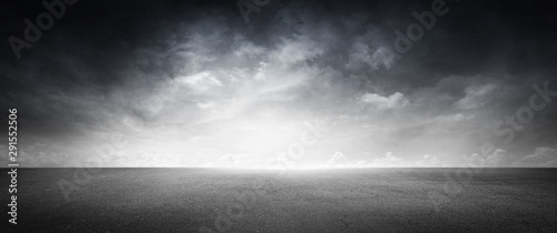 Obraz Black Floor Dark Background with Gray Sky and White Clouds - fototapety do salonu