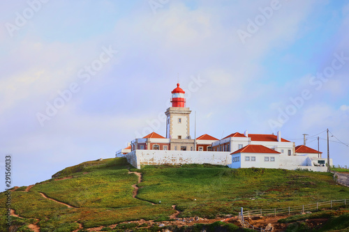 Foto auf AluDibond Cabo da Roca, Portugal. Lighthouse and cliffs over Atlantic Ocean, the most westerly point of the European mainland.