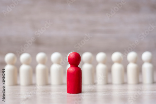 Obraz red leader businessman with crowd of wooden men. leadership, business, team, teamwork and Human resource management concept - fototapety do salonu
