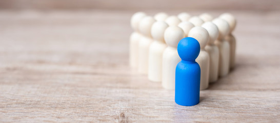 blue leader businessman with crowd of wooden men. leadership, business, team, teamwork and Human resource management concept