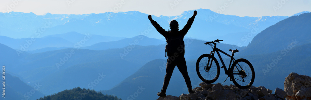 Fototapeta The Happiness of the Young Man Reaching the Summit