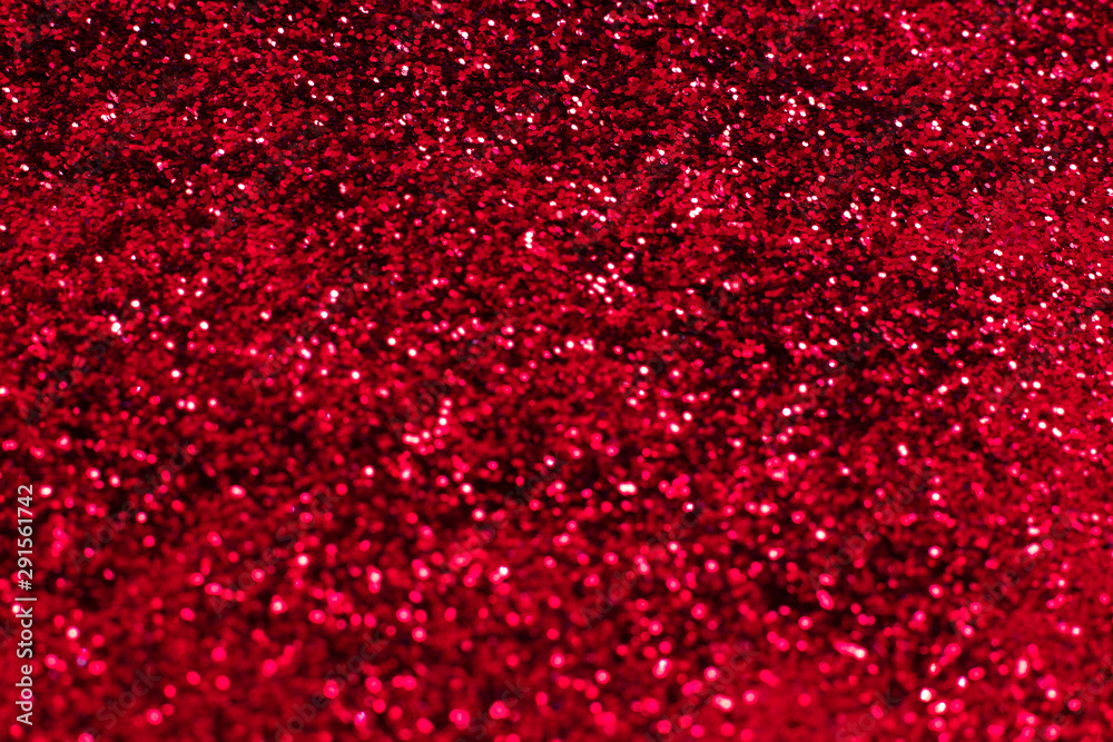 Fototapeta Red glitter texture. Festive sparkling sequins background closeup. Wpaper for Valentine, New Year or Christmas Holidays.