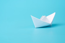 Origami White Paper Boat On Blue Background