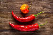 Two Red Banana Peppers And 1 H...