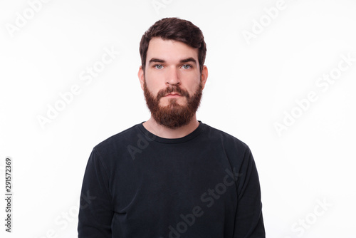 Fototapety, obrazy: Portrait of serious young man with beard looking at the camera
