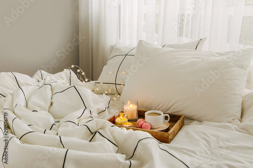 Fotografie, Obraz Wooden tray of coffee and candles on bed