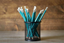 Lead Blue Pencils In Black Metal Holder Pot On A Wooden Background
