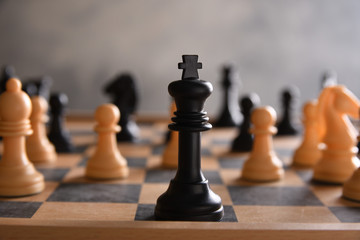 board game for ideas and strategy, business success concept. hand of businessman man moving chess figure in competition success play.  strategy, management or leadership concept.playing photographed