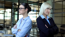 Two Business Women Standing Back To Back Looking Angrily, Career Competition