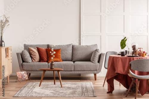 Door stickers Height scale Copy space on empty white wall of fashionable living room interior with grey and orange design