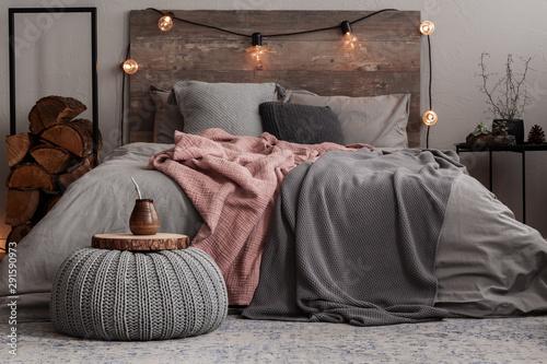 Yerba matte on wooden plate on grey woolen pouf in stylish bedroom interior Fototapet