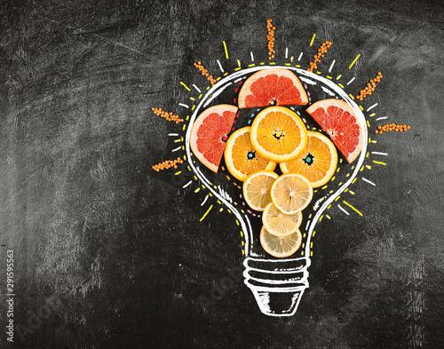 Light bulb with inside orange and lemon fruit - 291595563