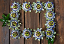 Passion Flowers On Dark Wooden Surface