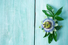 Passion Flowers On Turquoise Wooden Surface
