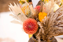 Autumn Bouquet Of Flowers In Natural Shades And Dried Flowers. Orange Dahlias, Yellow Roses, Protea, Spikelets