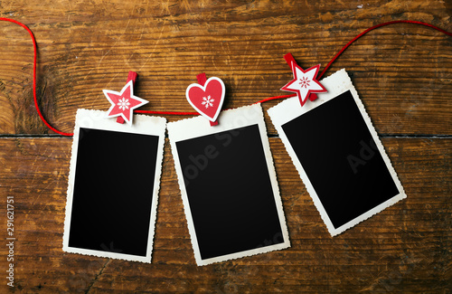 Obraz Blank christmas photo frames with fir tree and decor - fototapety do salonu