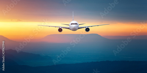 Front of real plane aircraft, isolated on sunset view background Fototapeta