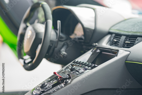 Interior photo of a Lamborghini sports car showing buttons and steering wheel Canvas Print