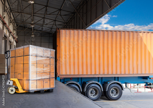 Photo truck docking load cargo at warehouse, hand pallet truck with goods pallet, freight industry warehouse logistics and transportation