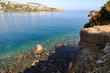 Blue water and rocky coast of the Aegean Sea as a background