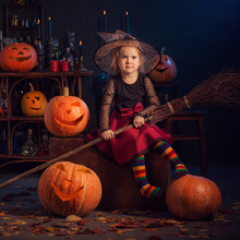 Little Witch With Halloween Pu...