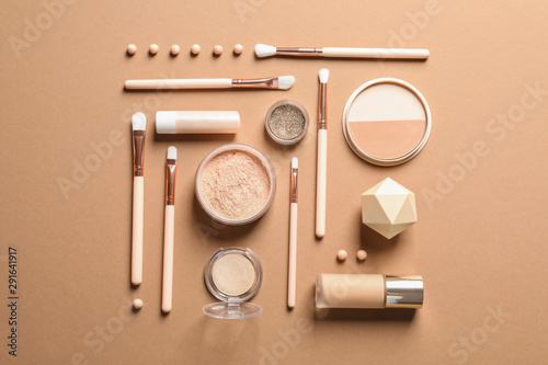 Flat lay composition with makeup brushes on brown background Wallpaper Mural