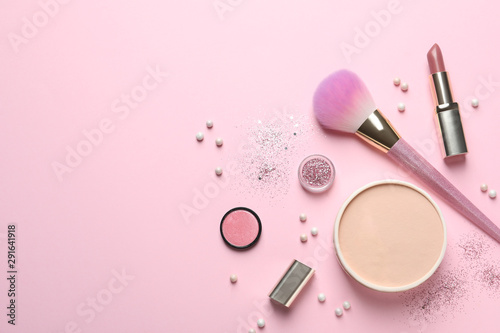 Flat lay composition with makeup brushes on pink background Canvas Print