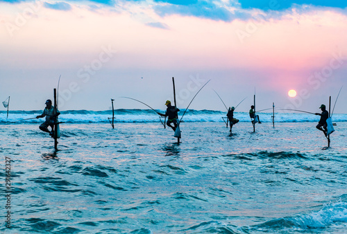 Photo sur Toile Amsterdam stilt fishermen at sunset in Sri Lanka