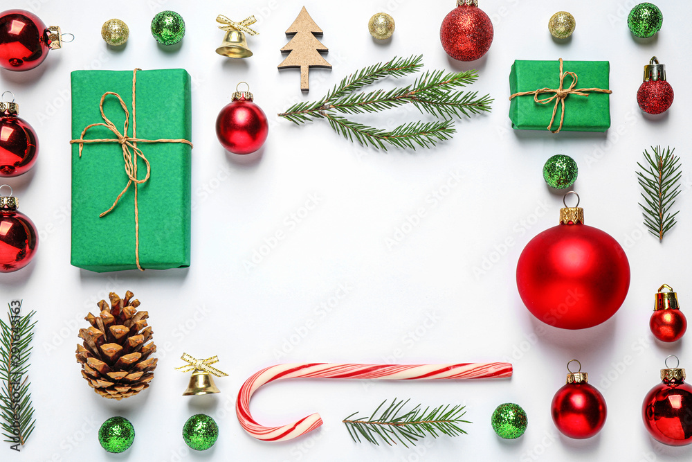 Fototapeta Frame of Christmas tree branches and festive decoration on white background, top view. Space for text