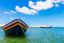Colorful Small Boat Anchored O...