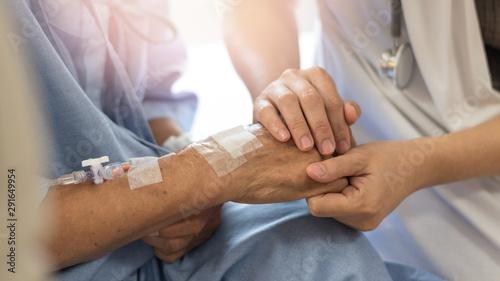 Fotografía Elderly female hand holding hand of young caregiver at nursing home