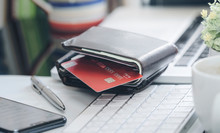 Wallet With Credit Card On Whi...