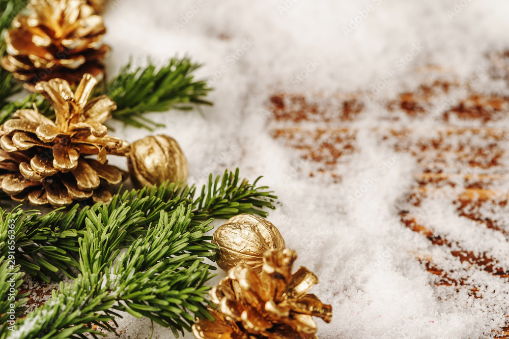 Fototapety, obrazy: Golden painted pine cone on snowy table, christmas decor
