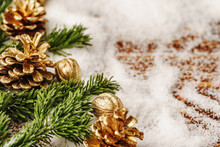 Golden Painted Pine Cone On Snowy Table, Christmas Decor