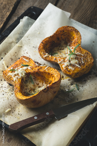 Baked pumpkin with spices and grated cheese