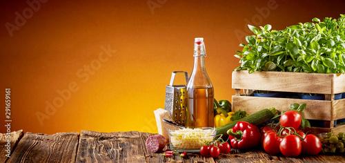 Fototapeta Ingredients for Italian cuisine in a pizzeria obraz