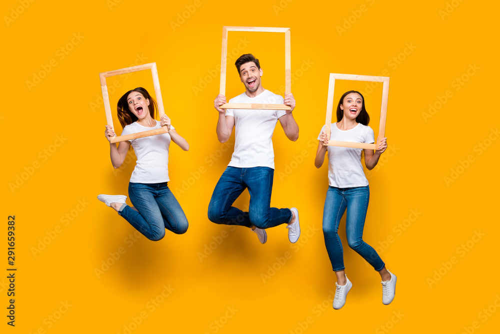 Fototapeta Full length body size view portrait of three nice attractive lovely cheerful cheery carefree person holding in hands frames having fun isolated over bright vivid shine yellow background