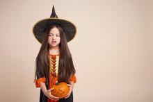 Little Witch With Halloween Pumpkin