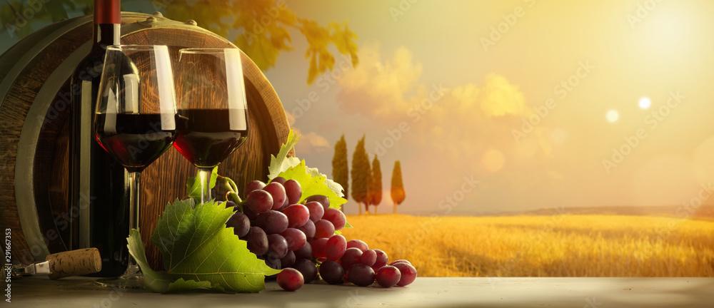 Fototapety, obrazy: autumn countryside wine background; vine, red wine bottles, wineglass, wine barrel; wine tasting concept