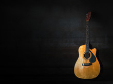 Acoustic Guitar On A Black Bac...